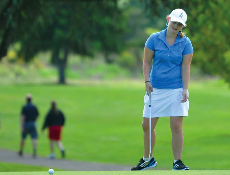 by: HILLSBORO TRIBUNE PHOTO: ZACK PALMER - Liberty junior Stephanie Miller looks on in frustration as her putt stops short of the hole on the 18th green at Emerald Valley Golf & Resort.