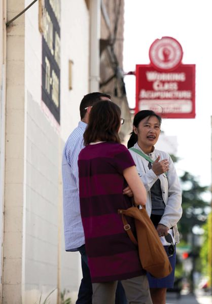 by: TRIBUNE PHOTO: JONATHAN HOUSE - PDCs Trang Lam talks about the improvements coming to the Lents neighborhood.