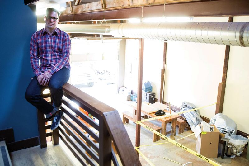 by: TRIBUNE PHOTO: JONATHAN HOUSE - Jason French of Ned Ludd on the second story of where his new event space is being built.