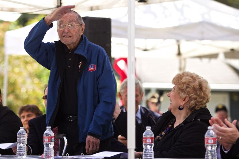 by: TIMES PHOTO: JAIME VALDEZ - Curtis Tigard, 105, acknowledges the crowd after being recognized as Washington County's oldest living World War II veteran. Oregon American Legion Commander Mike Morris welcomed the former Army officer as a member of the Legion. during Beaverton Post 124's annual Memorial Day program.