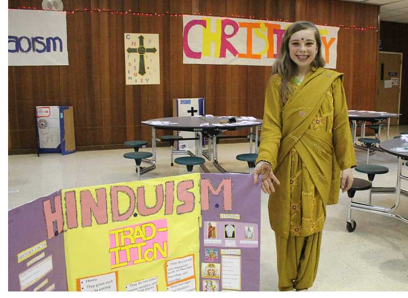 by: LINDSAY KEEFER - Mary Kaufman was one of North Marion Middle School's seventh-graders who participated in the world religions night at the school May 20. The event allowed her to showcase her knowledge of Hinduism.