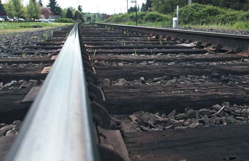 by: SPOKESMAN PHOTO: JOSH KULLA - If Wilsonville ultimately is selected for a new rail station on a proposed high speed line, the existing Oregon Electric Company line, shown here, would be overhauled at considerable cost.