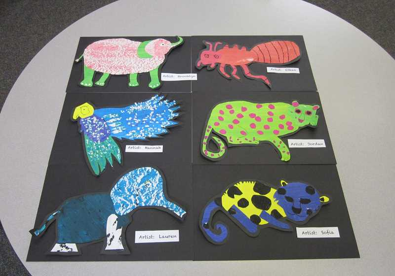 by: GAZETTE PHOTO: BARBARA SHERMAN - These fanciful animals were created in one session by Middleton fifth-graders using colorful paper that was previously painted by all the students in the school.