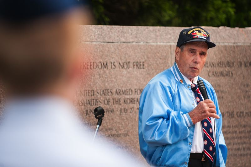 by: SPOKESMAN PHOTO: JOSH KULLA - Chuck Lusardi, President of the Oregon Trail Chapter of the Korean War Veterans Association, speaks Monday at a Memorial Day commemoration at Wilsonvilles Korean War Memorial.