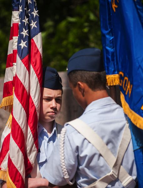 by: SPOKESMAN PHOTO: JOSH KULLA - Aurora Squadron Civil Air Patrol members served as color guard Monday at a Memorial Day commemoration in Wilsonville.