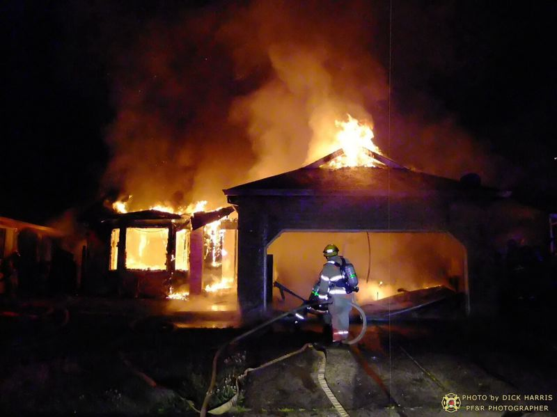 by: PORTLAND FIRE & RESCUE/DICK HARRIS - A fire in a vacant house damaged two nearby homes.