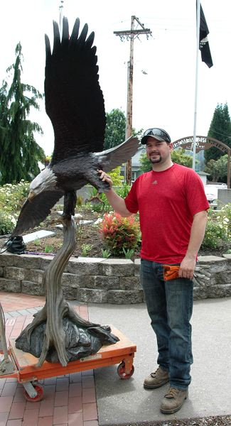 by: ESTACADA NEWS PHOTO: BEVERLY CORBELL - Roy Swan of Bend Bronze Fine Art Casting with the new eagle his company cast for Estacada Veterans Memorial