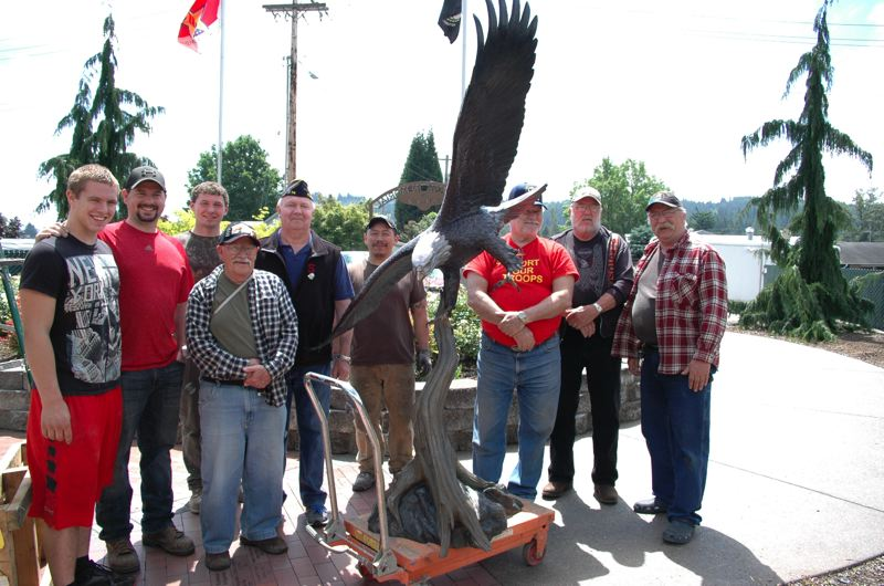 by: ESTACADA NEWS PHOTO: BEVERLY CORBELL - Working to install a new bronze eagle at the Estacada Veterans Memorial are, from left, Roy Swan Jr., Roy Swan, Shane Stofner, Jim Beltarmo, Jim Grimes, Mario Pinto, Terry Brown, Dennis Dahrens and John Nieder.