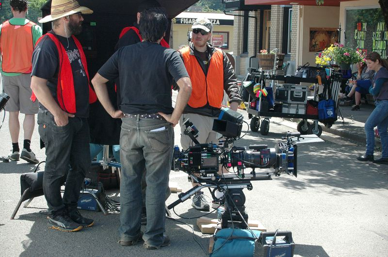 by: ESTACADA NEWS PHOTO: BEVERLY CORBELL - Crews in Estacada for the filming of The Librarians for TNT take a break before shooting a scene on Broadway Street.
