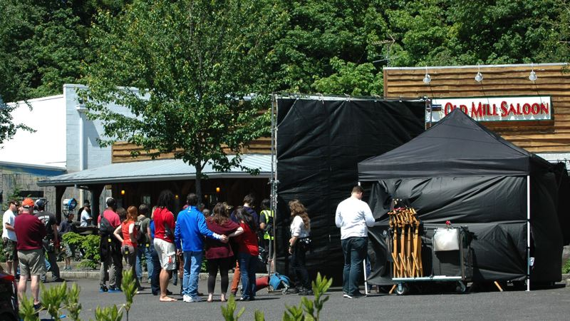 by: ESTACADA NEWS PHOTO: BEVERLY CORBELL - About 80 crew members from The Librarians for TNT prepare to shoot a scene with an explosion at the Old Mill Saloon.