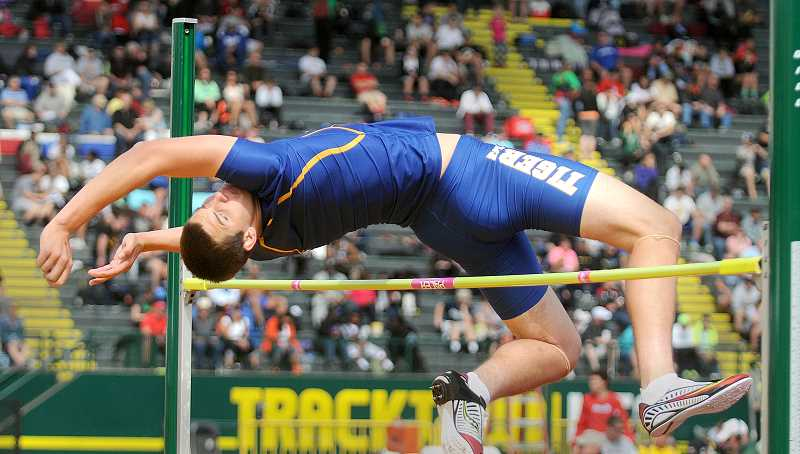 by: SETH GORDON - So close - Jacoby Wolfe gets most of the way over the bar in an attempt to clear the bar at 6-3 in the high jump Saturday at the 6A state track and field championships in Eugene. Wolfe tied for 12th by clearing 6-2.
