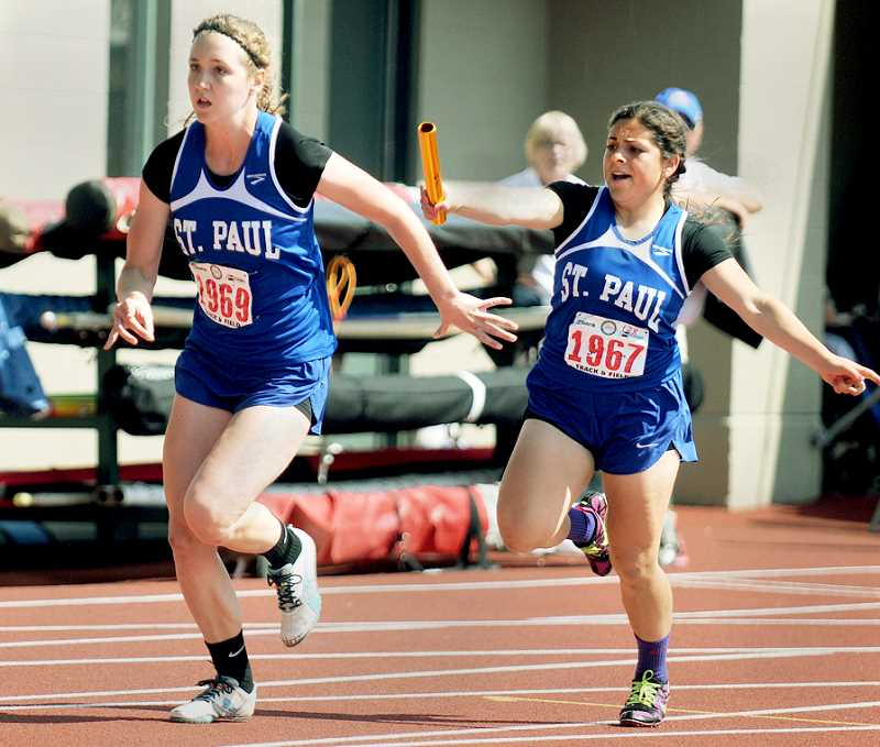 by: SETH GORDON - Hand to hand - St. Paul senior Carolina Ruvalcaba passes the baton to classmate Delaney Sump during the 4x100 relay Friday at the 1A state championships at Hayward Field in Eugene. The Bucks did not earn a historic 3-peat in the event, but did place second in a season's best time of 52.35 seconds.