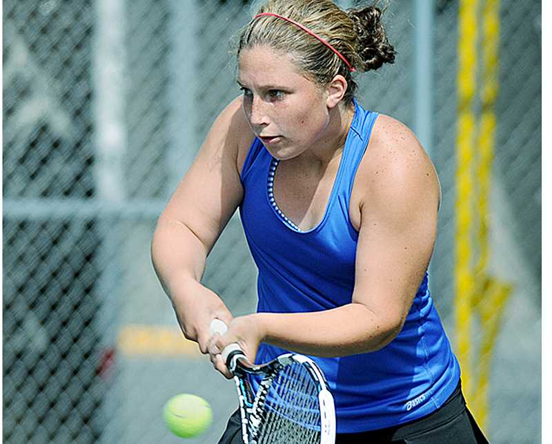 by: STH GORDON - Return to sender - Newberg senior Sam Russo hits a shot during her opening round match at the 6A state championships May 22 at the Portland Tennis Center.