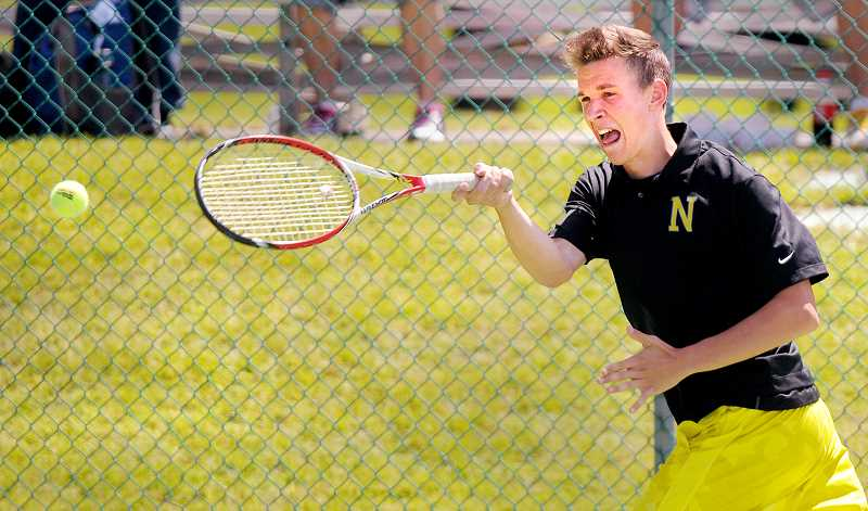 by: SETH GORDON - Right back at ya' - Newberg senior Barry Vernon returns serve during the 6A boys state tournament May 22 at the Tualatin Hills Recreation Center. He and partner Aidan Thillmann beat South Salem's Austin Benage and Noah Webster 4-6-6-1, 6-1 to advance to the state quarterfinals.