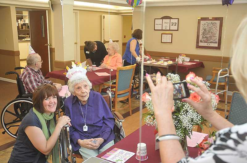 by: GARY ALLEN - Mildred 'Micky' Downey poses for a photo with her granddaughter Anne Marie during a celebration of her 100th birthday May 22 at Willow Place Assisted Living.