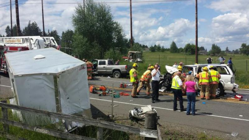 by: OREGON STATE POLICE - Responders arrive at the scene of a two-vehicle crash on Highway 213 Tuesday morning that involved a Woodburn woman.