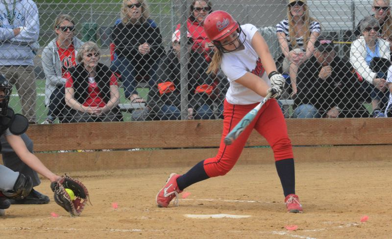 by: TIMES PHOTO: MATT SINGLEDECKER - Westview designated hitter Natalie Munn takes a cut a below-the-belt fastball against Clackamas.
