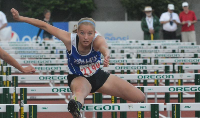 by: TIMES PHOTO: MATT SINGLEDECKER - Valley Catholic senior Mikaela Bernards took second in the 100-meter hurdles at the 3A State Championships on Friday to help the Valiants take home a team title.