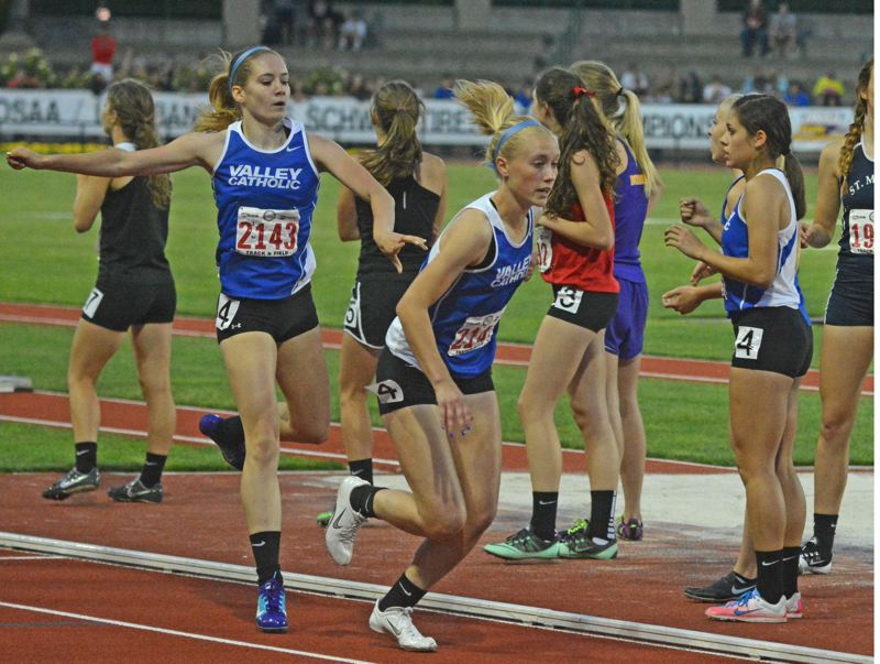 by: TIMES PHOTO: MATT SINGLEDECKER - Valley Catholic freshman Julia Clark hands off to Reilly Blood for the third leg of the 4x400 relay at the 3A State Championships on Friday.