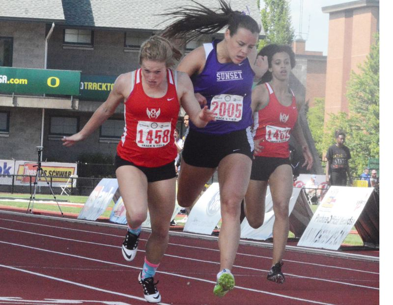 by: TIMES PHOTO: MATT SINGLEDECKER - Sunset senior Taylor Coon tried to battle past Oregon Citys Becca Houk in the 200-meter dash, but couldnt get past the Pioneer at the finish lineat the 6A State Championships on Saturday.
