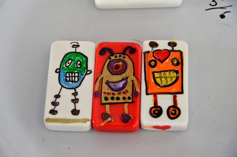 by: SUBMITTED PHOTO - FriendBots (or GoodLuckBots or Joy Bots) are friendly, painted dominos that come with a positive message.