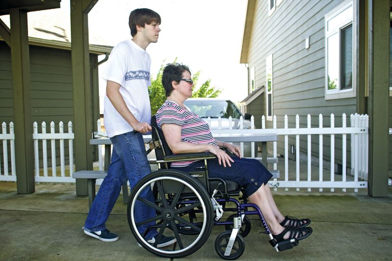 by: TRIBUNE PHOTO: JAIME VALDEZ - Seventeen-year-old Luke Hilger has been helping care for his mom, Amy, since she developed Huntingtons Disease when Luke was 12. Watching Amy decline, Luke has been confronted with a decision - whether he wants to take a test to determine if he will also develop the disease.