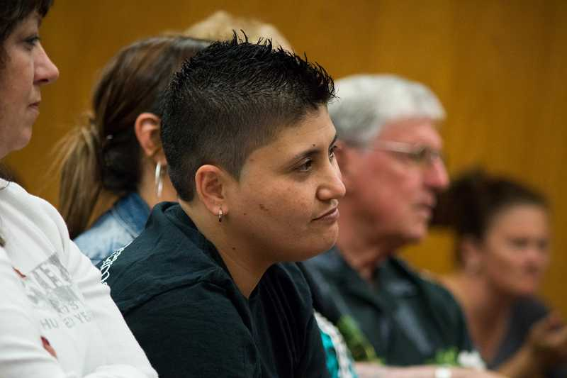 by: PAMPLIN MEDIA GROUP PHOTO: CHASE ALLGOOD - Hillsboro resident Tiare Mathews listens to Judge Thomas Kohl at her Washington County Drug Court graduation ceremony May 19. Her father, Howard Mathews of Phoenix, Az., is in the background. Mathews says she 'put my dad through hell,' but that he always believed in her. 'She's the light of her dad's life,' said Tiare's stepmother, Cindy Mathews. 'This is what he's always wanted for her.'