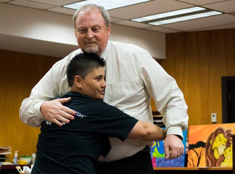 by: PAMPLIN MEDIA GROUP PHOTO: CHASE ALLGOOD - Tiare Mathews, Washington County Drug Court's 145th graduate, hugs her probation officer, David Cadd.