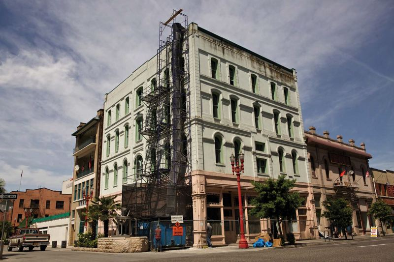 by: TRIBUNE PHOTO: JAIME VALDEZ - Renovations have begun on the Society Hotel project, where developers plan a ground-floor cafe and Old Town/Chinatowns first tourist hotel.