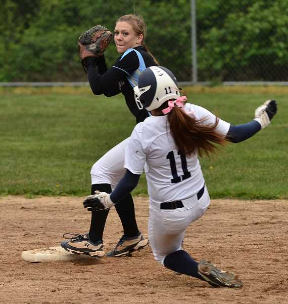 by: REVIEW FILE PHOTO: VERN UYETAKE - Lakeridge's Bailey Morris looks to turn a double play in the Pacers victory in a recent softball game with Lake Oswego.