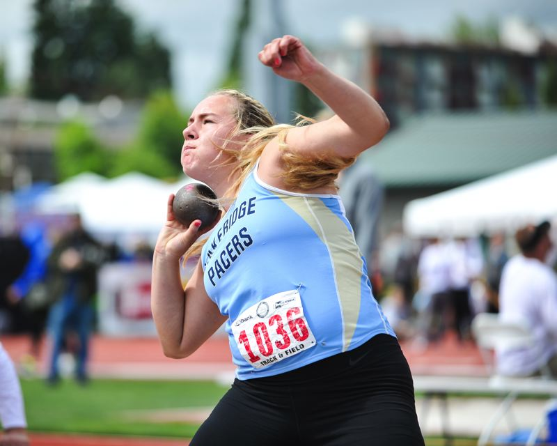 by: JOHN LARIVIERE - Lakeridge sophomore Maddie Rabing was one of the favorites in the shot put all season and easily won the event in Eugene last week. She also took second place in the discus.