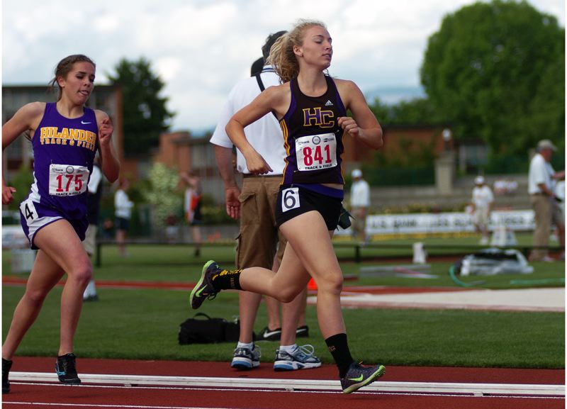 by: DAN BROOD - RUNNING STRONG -- Horizon Christian junior Hannah Cesario keeps up the pace in the 1,500-meter run at the Class 3A state track and field championships.