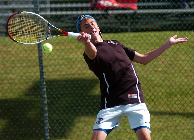 by: DAN BROOD - STATE SMASH -- Tualatin sophomore Ryan Malinowski hits a forehand shot during his first round victory at the Class 6A state tournament.