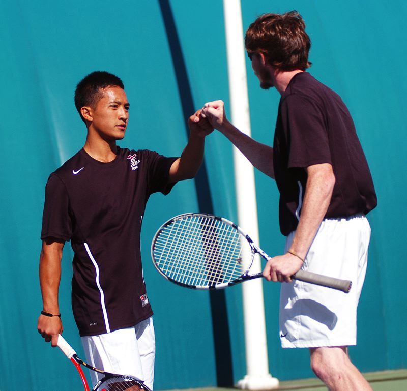 by: DAN BROOD - TUALATIN TEAMMWORK -- Tualatin's Dahn Nguyen (left) and Tyler Snyder picked up a victory in their first round doubles match at the Class 6A state tournament.