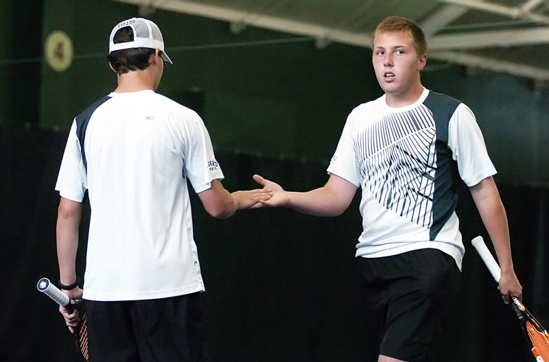 by: DAN BROOD - TIGERS AT STATE -- Tigard seniors Mitchell Davis (left) and Tanner Ahl picked up a victory in the consolation bracket at the Class 6A state tournament.