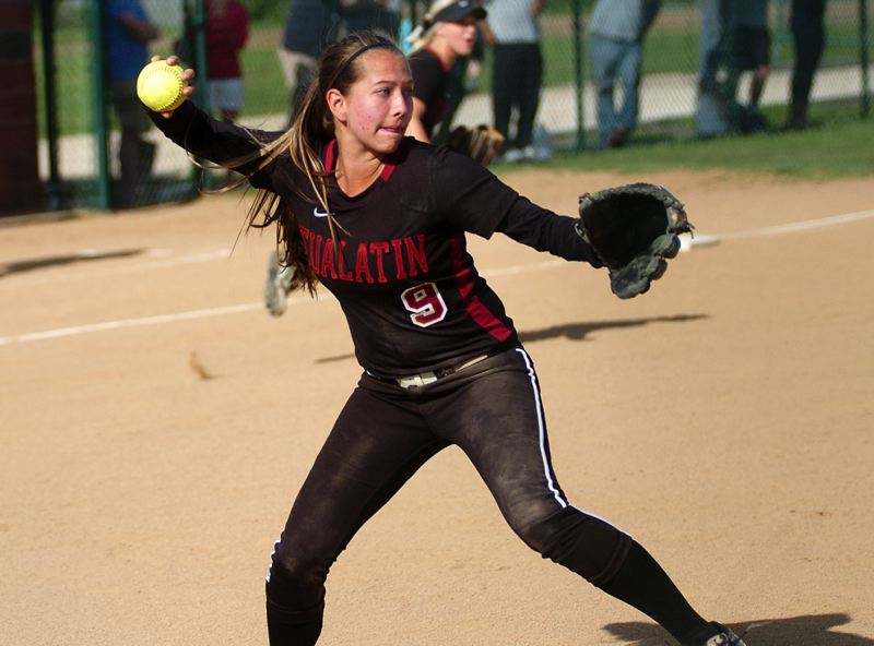 by: DAN BROOD - TURNING TWO -- Tualatin junior first baseman Sarah Kailiuli looks to make a throw to first base after fielding a bunt pop-up in Monday's state playoff game.