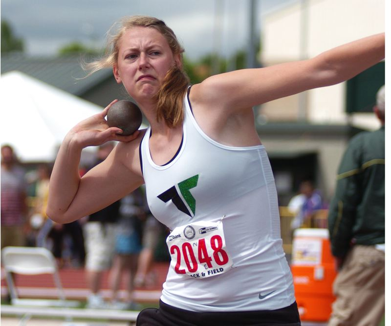 by: DAN BROOD - LOADING UP -- Tigard High School sophomore Elise Conroy gets ready to throw the shot put during action Saturday at the Class 6A state track and field championships. Conroy placed second with a mark of 39-3.25.
