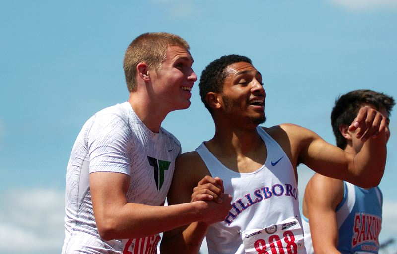 by: DAN BROOD - GOOD TIMES -- Tigard sophomore Tyler Rosette (left) shares a laugh with Hillsboro's Cricket Browning following the 400.