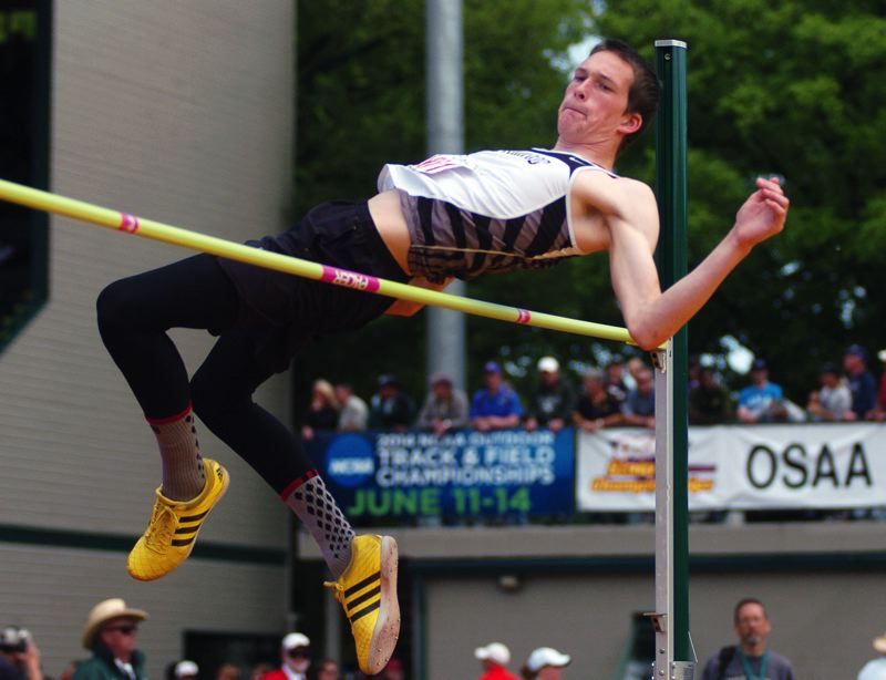 by: DAN BROOD - BEN OVER THE BAR -- Sherwood High School junior Ben Milligan took second place in the Class 5A boys high jump competition Saturday at Hayward Field in Eugene. Milligan cleared a height of 6-7.