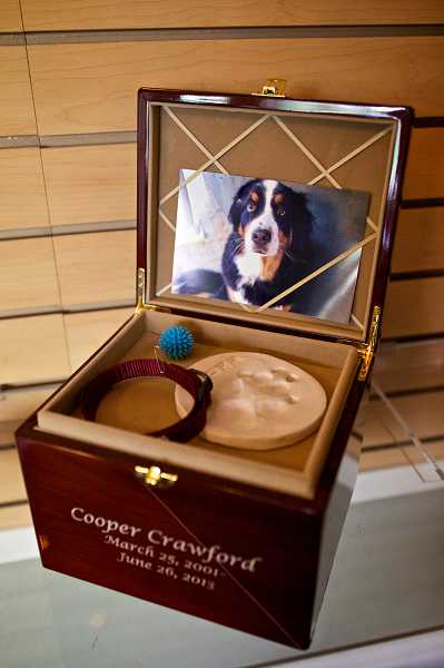 by: TIMES PHOTO: JAIME VALDEZ - Dignified Pet Services in Tualatin offers a variety of urns for clients to place their pet's remains.