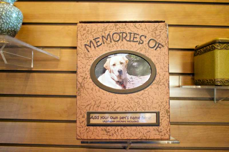 by: TIMES PHOTO: JAIME VALDEZ - A variety of urns are available for clients to place their pet's remains at Dignified Pet Services in Tualatin.