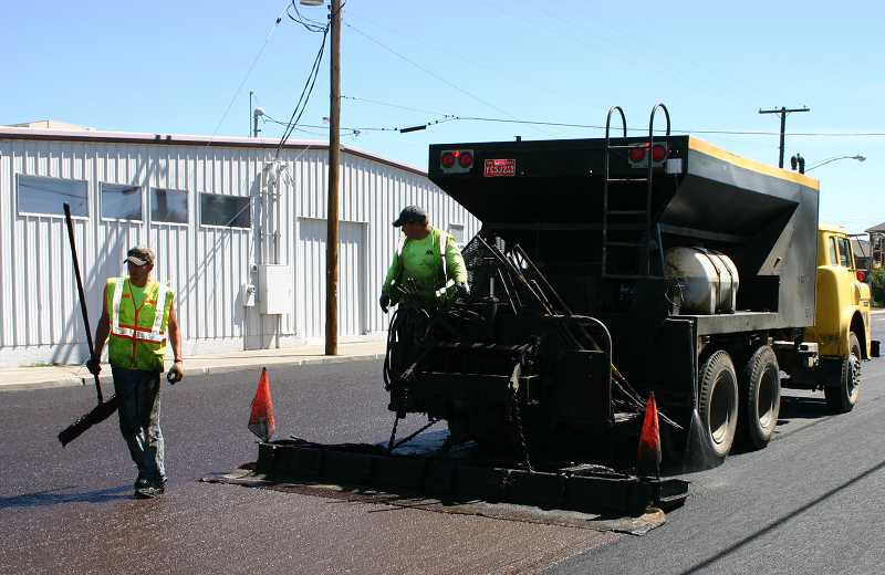 by: CENTRAL OREGONIAN - The City of Prineville applied a slurry seal treatment to a portion of a street in spring 2013. They will utilize the method extensively this summer.