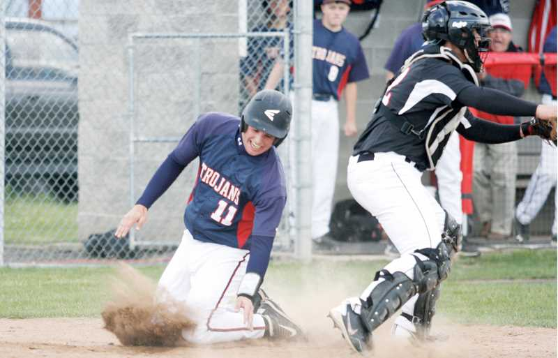by: PHIL HAWKINS - Blake Traeger put the Trojans on the board with an RBI and a run scored in the first inning. Traeger led the team with three hits and four RBIs in the victory over the Braves