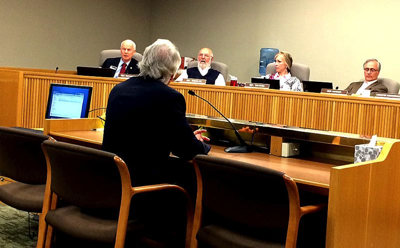 by: TRIBUNE PHOTO: PETER WONG - Gov. John Kitzhaber (back to camera) answered questions Thursday afternoon from his GOP gubernatorial rival, state Rep. Dennis Richardson (far left on dais), during a legislative committee hearing in Salem on the problems with Cover Oregon.