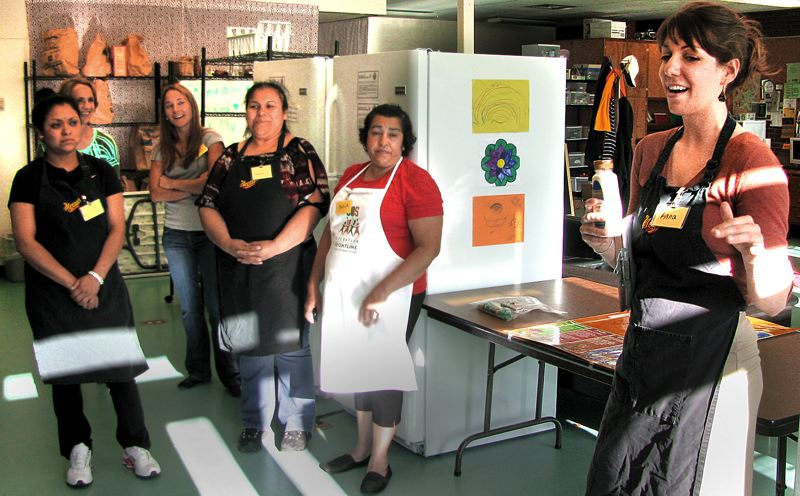 by: OUTLOOK PHOTO: LISA K. ANDERSON - Maria Castro Guzman, Gloria Castro Guadian, Salud Aguilar Avila and Anna Markley, school pantry coordinator and chef instructor, share a laugh as they prepare to make three entrées - pasta with green beans, apple raisin salad and peanut butter banana pockets.