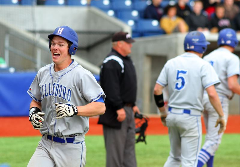 by: HILLSBORO TRIBUNE PHOTO: CHASE ALLGOOD - HillHi's Chase Kaplan celebrates a score in the Spartans' 5-4 win on Wednesday.
