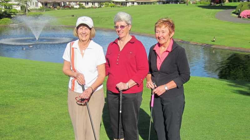by: BARBARA SHERMAN - THREE IN A MILLION - Gathered together on a recent ladies' play day near the site of their respective golf triumphs are Jane Brown (left), Marilyn Launder and Joann Casciato.