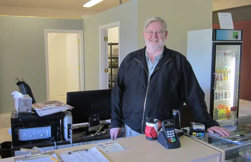 by: BARBARA SHERMAN - CONSTRUCTION ZONE - King City Pro Shop manager Harold Washam is on duty despite temporarily working in a construction zone.