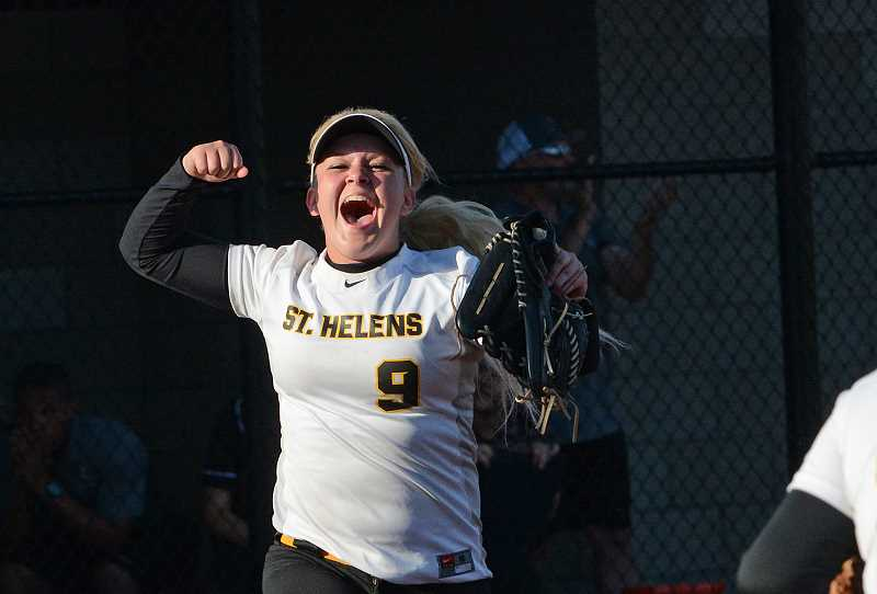 by: JOHN WILLIAM HOWARD - Alyssa Geisbers cheers after the Lions got the final out of the eighth inning, sending St. Helens to the state semifinals with Rex Putnam. It was Geisbers who beat the ball to third base in the top of the period, allowing Taylor Leal to score and give the Lions a 1-0 lead.