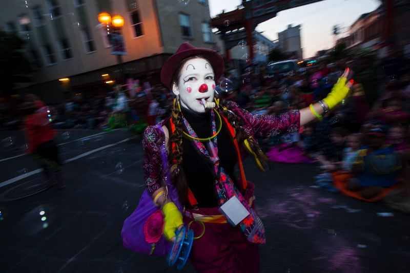 by: TRIBUNE PHOTO: JEFFREY BALL - The festival's Clown Corps delighted the crowd of thousands who lined downtown streets for hours to see the Starlight Parade.